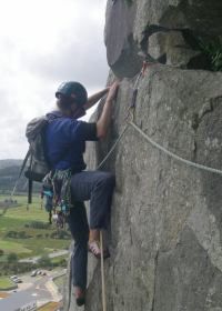 Alice as a climbing guide on Creagh Dhu Wall at Tremadog, North Wales