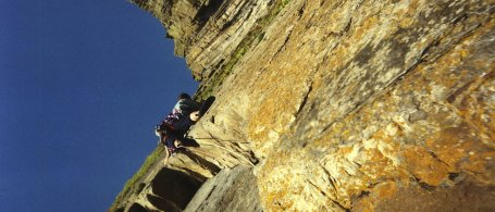 Rock climbing at Long Rock Slab, Devon